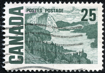 CANADA - CIRCA 1967: a stamp printed in the Canada shows The Solemn Land, Oil Painting by J. E. H. MacDonald, circa 1967 Editorial