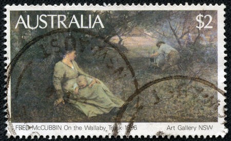 AUSTRALIA - CIRCA 1981: Postage stamp printed in Australia with image of a 1896 painting, On the Wallaby Track, by Fred McCubbin from the Art Gallery of South Australia.