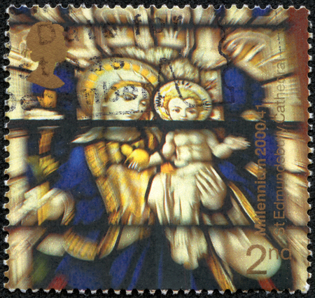 UNITED KINGDOM - CIRCA 2000: A stamp printed in Great Britain shows Madonna and child, stained glass window, st edmundsbury cathedral (suffolk cathedral milennium project), circa 2000 photo