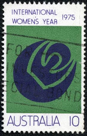 womanhood: AUSTRALIA - CIRCA 1975: a stamp printed in the Australia shows Symbols of Womanhood, Sun, Moon, International Women \\ \ s Year, circa 1975 Editorial