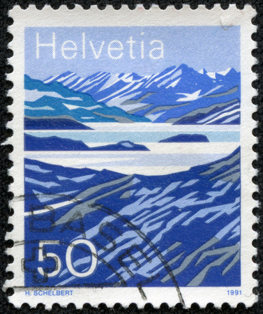 helvetia: SWITZERLAND - CIRCA 1991: a stamp printed in the Switzerland shows Mountain Lakes, Switzerland, circa 1991 Stock Photo