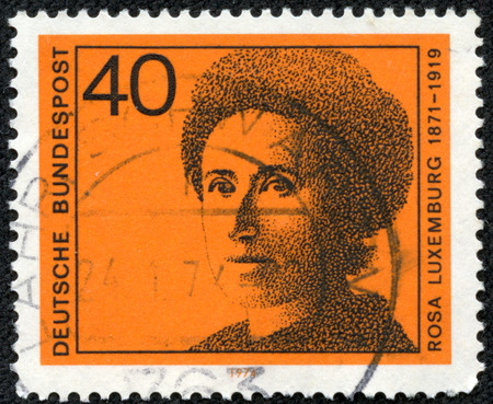 political economist: GERMANY - CIRCA 1974: A stamp printed in Germany shows Rosa Luxemburg (1871-1919), series Honoring German women writers and leaders in political and women \