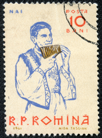 ROMANIA-CIRCA 1961: A stamp printed in ROMANIA shows image of The pan flute or pan pipe is an ancient musical instrument based on the principle of the closed tube, circa 1961.