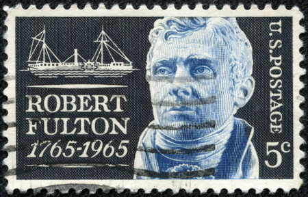 credited: UNITED STATES - CIRCA 1965: A United States Postage Stamp in memory and in honor of American Engineer and Inventor Robert Fulton - credited with creating the first commercial Steamboat, circa 1965.