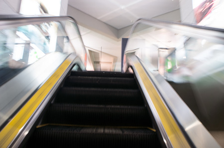escalator, interior of airport photo