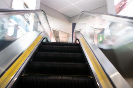 escalator, interior of airport photo