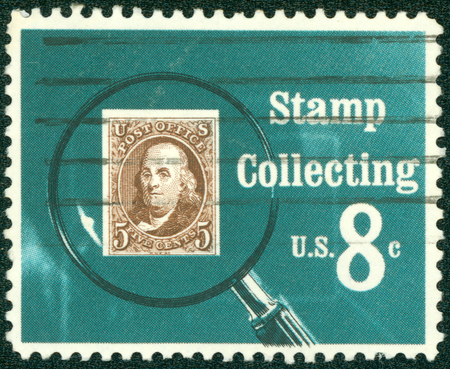 usps: UNITED STATES OF AMERICA - CIRCA 1972: A stamp printed in USA shows Pictures magnifying glass over United States postage stamp, circa 1972