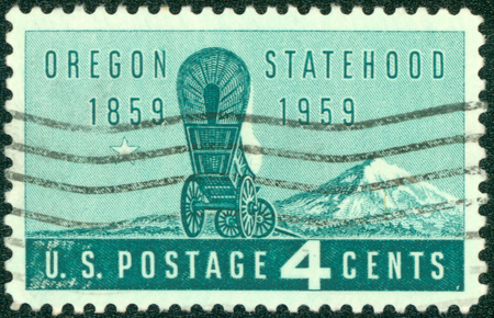 UNITED STATES OF AMERICA - CIRCA 1959: Stamps printed in United State of America with image of a covered stagecoach wagon & Mt. Hood to commemorate Oregon Statehood, circa 1959.