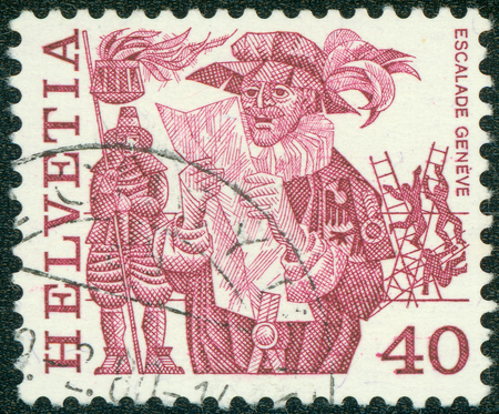 scaling: SWITZERLAND - CIRCA 1977: A stamp printed in Switzerlandis depicted Herald reading proclamation and men scaling wall, Geneva, circa 1977 Editorial