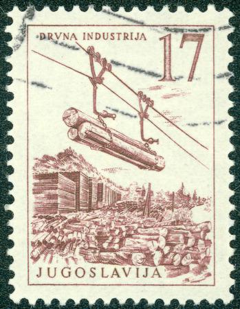 YUGOSLAVIA - CIRCA 1966: A stamp printed in Yugoslavia shows lumber industry, circa 1966
