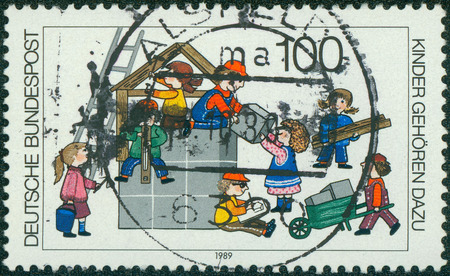 nurser: GERMANY - CIRCA 1989: Postage stamp printed in Germany, shows children are building a house, circa 1989