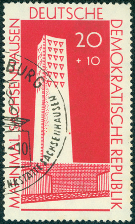 sachsenhausen: EAST GERMANY - CIRCA 1961: A stamp printed in East Germany shows image of the Sachsenhausen Concentration Camp Memorial, series, circa 1961 Editorial