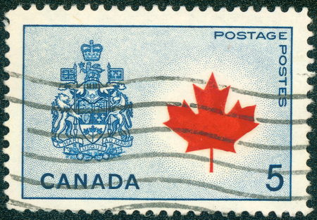 CANADA - CIRCA 1966: a stamp printed in the Canada shows Maple Leaf and Arms of Canada, circa 1966 photo