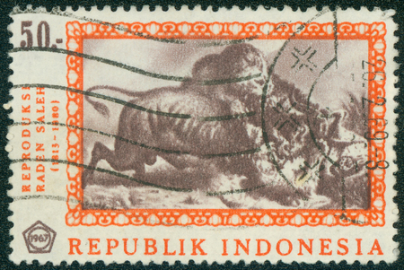 postes: INDONESIA - CIRCA 1967: A stamp printed in Indonesia from the \ Paintings by Raden Saleh \ issue shows \ A Fight to the Death \, circa 1967.