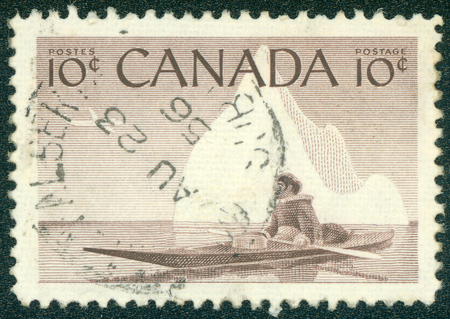 inuit: CANADA - CIRCA 1955 A stamp printed in The Canada shows image of an Inuit floating in kayak behind polar circle, circa 1955