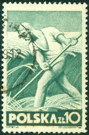 polska: POLAND - CIRCA 1947: A stamp printed by POLAND shows Farmer harvests, circa 1947