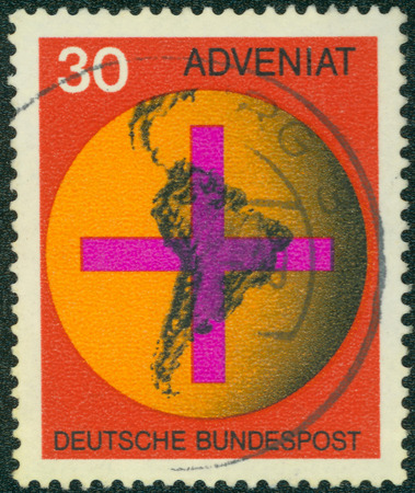 bundespost: GERMANY - CIRCA 1967: A stamp printed in Federal Republic of Germany honoring Adveniat - Aid for Catholic Church in Latin America, shows Cross on South American Map, circa 1967