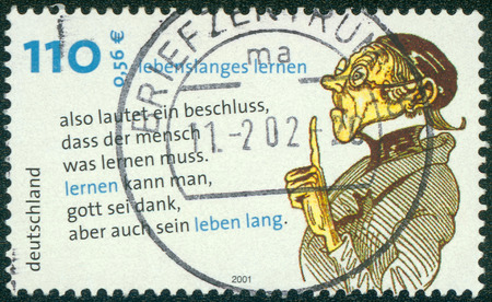 blackly: GERMANY - CIRCA 2001: Postage stamp printed in Germany, Lifelong Learning, shows Lehrer Laempel, drawing and quotes by Wilhelm Busch, circa 2001