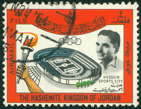 JORDAN-CIRCA 1967: A stamp printed in Jordan shows image of King Hussein and stadium sports city, circa 1967. Editorial