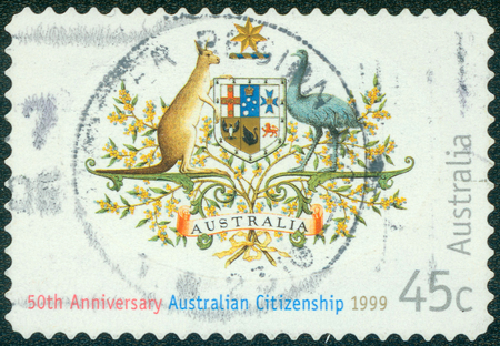 citizenship: AUSTRALIA - CIRCA 1999: Postage stamp printed in Australia, dedicated to the 50th anniversary of the Nationality and Citizenship Act, shows State Emblem, circa 1999