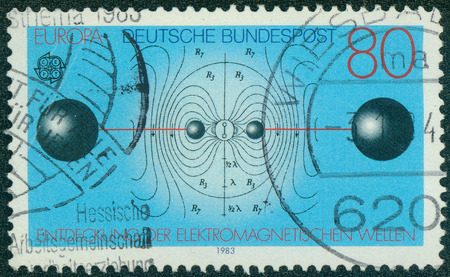 flux: GERMANY - CIRCA 1983: A stamp printed in German Federal Republic shows Resonant Circuit, Electric Flux Lines, Discovery of Electromagnetic Waves by Heinrich Hertz, circa 1983 Editorial