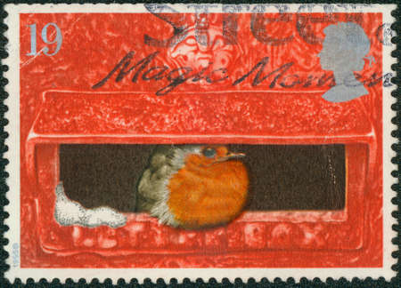 UNITED KINGDOM - CIRCA 1995: A stamp printed in United Kingdom from the \\\Christmas \\\ issue shows European Robin in Mouth of Pillar Box, circa 1995.