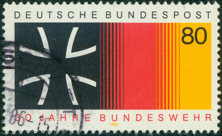 cross armed: GERMANY - CIRCA 1985: a stamp printed in the Germany shows Iron Cross and National Colors, 30th Anniversary of National Armed Forces, circa 1985 Editorial