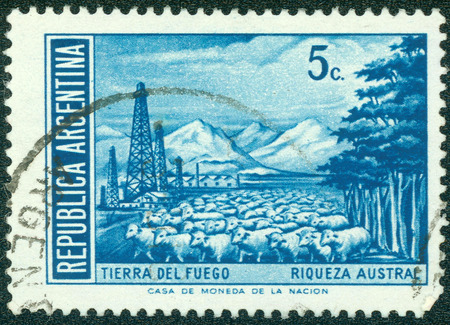 tierra: ARGENTINA - CIRCA 1959: A stamp printed in the Argentina, shows landscape of the Tierra del Fuego and flock of sheep, circa 1959