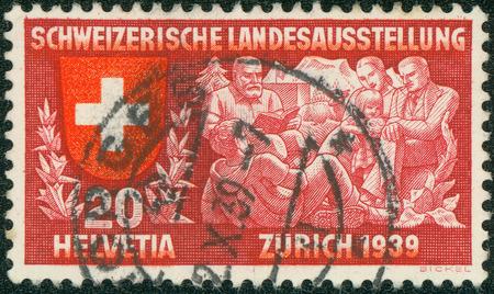 national poet: SWITZERLAND - 1939: stamp printed in Switzerland shows coat of arms of confederation, family listen to Senn Alm, poet, symbolizing spiritual life, Switzerland national exhibition, circa 1939 Editorial