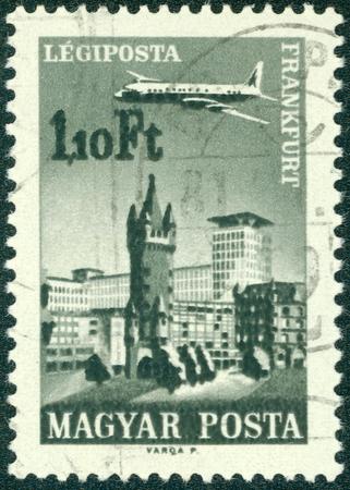 HUNGARY - CIRCA 1966: A stamp printed in Hungary shows plane abowe Frankfurt am Main, aircraft, Eschenheimer Turm and Eschenheimer Gate, circa 1966