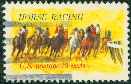 kentucky derby: USA - CIRCA 1974: Postage stamp printed in the USA, dedicated to the 100th anniversary of racing on horseback Kentucky Derby shows Horses Rounding Turn, circa 1974 Editorial