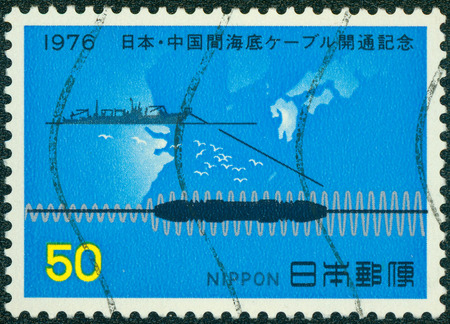 chinese postage stamp: JAPAN - CIRCA 1976: A stamp print in JAPAN show Submarine Cable System between JAPAN and china, circa 1976. Editorial