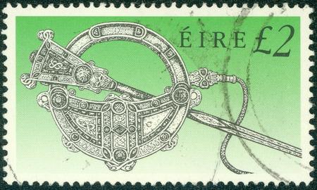 tara: IRELAND - CIRCA 1990: a stamp printed in the Ireland shows Tara Brooch, Art Treasure of Ireland, circa 1990