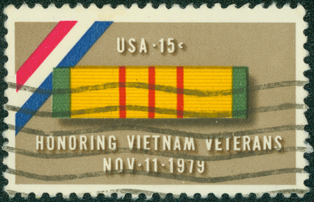 united states postal service: USA - CIRCA 1979: Postage stamp printed in USA, is dedicated to a tribute to veterans of the Viet Nam War, shows Ribbon for Viet Nam Service Medal, circa 1979