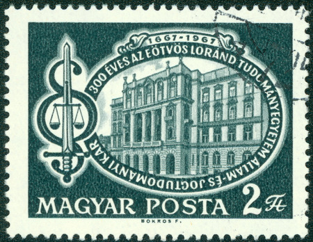 sword act: HUNGARY - CIRCA 1967: A stamp printed in Hungary issued for the 300th anniversary of Political Law and Science Faculty, Lorand Eotvos University, Budapest shows Faculty Building, circa 1967.