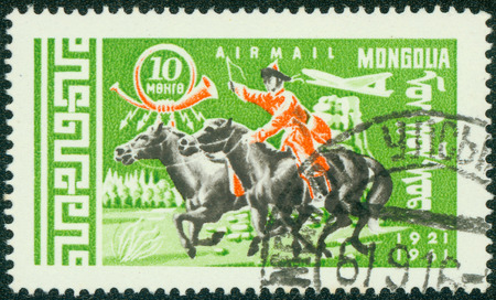 mongolia horse: MONGOLIA - CIRCA 1961: stamp printed in Mongolia, shows Mongolian rider on horse, series, circa 1961 Stock Photo