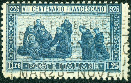 orison: ITALY - CIRCA 1926: Postage stamp printed in Italy, dedicated to the 600th anniversary of the death of St. Francis of Assisi, circa 1926 Stock Photo