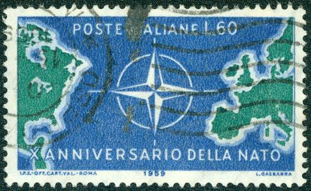 nato: ITALY - CIRCA 1959: stamp printed by Italy, shows Map of North Atlantic and NATO Emblem, circa 1959 Stock Photo
