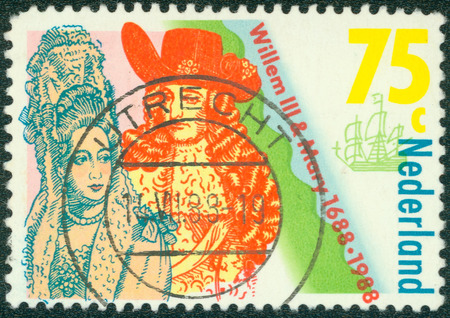 coronation: NETHERLANDS - CIRCA 1988: a stamp printed in the Netherlands shows Coronation of William III and Mary Stuart, King and Queen of England, 300th anniversary, circa 1988