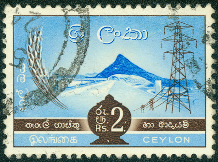 CEYLON - CIRCA 1960: A stamp printed in Ceylon (now Sri Lanka) shows image of a hydro-electric power station, circa 1960 photo