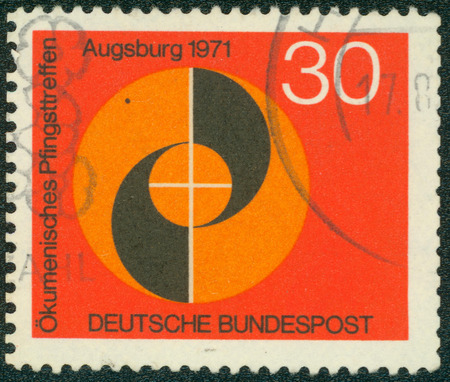 bundespost: GERMANY - CIRCA 1971: a stamp printed in the Germany shows emblem of congress, ecumenical meeting at pentecost of the german evangelical and catholic churches, Augsburg, circa 1971 Stock Photo
