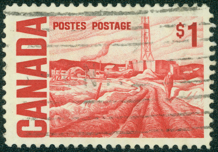 canada stamp: CANADA - CIRCA 1967: a stamp printed in the Canada shows Oilfield near Edmonton, Painting by HG Glyde, circa 1967 Stock Photo
