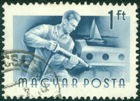 """magyar: HUNGARY - CIRCA 1955: A stamp printed in Hungary shows Riveter, without inscription, from the series \\ \ """"Hungary Workers \\\"""", circa 1955 Stock Photo"""