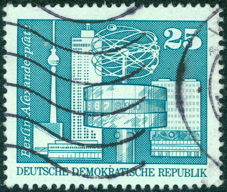 east germany: GDR - CIRCA 1980: A stamp printed in East Germany shows image of the Alexanderplatz in Berlin, series, circa 1980 Stock Photo