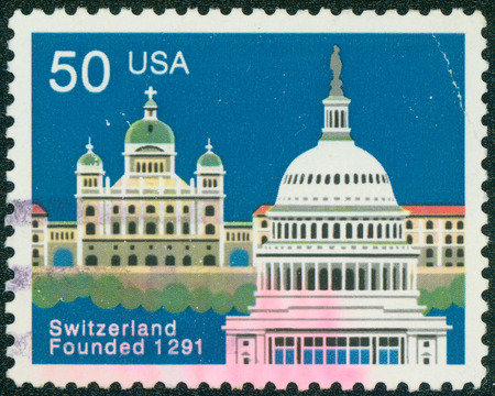 USA - CIRCA 1991: A stamp printed in USA issued for the 700th anniversary of Swiss Confederation shows Federal Palace, Bern and Capitol, Washington, circa 1991. photo