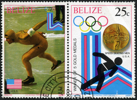 BELIZE - CIRCA 1980: a stamp printed in Belize shows the gold medal in speed skating men, Winter Olympics, Portugal, circa 1980