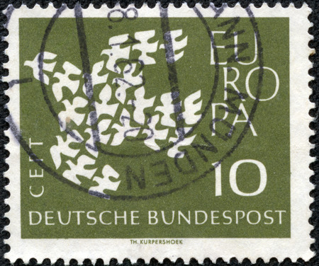 bundespost: GERMANY - CIRCA 1961: Postage stamp printed in Germany, shows 19 pigeons, arranged as a flying Dove, circa 1961 Stock Photo