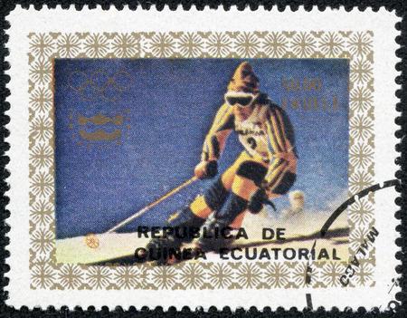 rival rivals rivalry season: EQUATORIAL GUINEA - CIRCA 1976: A stamp printed in Equatorial Guinea, shows Skiing, circa 1976