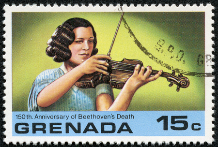 beethoven: GRENADA - CIRCA 1978: A stamp printed in Grenada issued for the 150th Anniversary of Beethoven Death shows woman violinist, circa 1978.