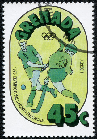 stempel: GRENADA - CIRCA 1976: A stamp printed in Grenada from the Olympic Games, Montreal  issue shows Hockey, circa 1976. Editorial